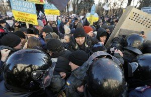 Anti-austerity protest in Kyiv on Dec 23, 2014, photo by Sergey Dolzhenko, EPA