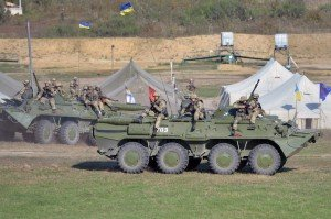 Ukrainian soldiers on armored personnel carrier during Exercise Rapid Trident near Yavoriv, Ukraine, Sept. 19, 2014, photo by Michael Abrams-Star and Stripes