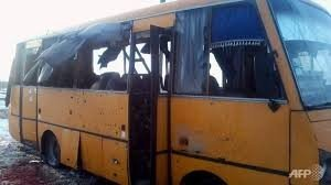 Bus hit by GRAD rockets at town of Volnovakha, Ukraine on Jan 13, 2015, photo AFP