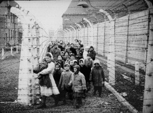 Child survivors of Auschwitz led out by relief workers and Soviet (including Ukrainian) soldiers, Jan. 1945