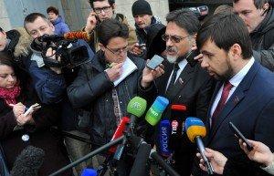 Vladislav Deinego and Denis Pushilin talk to reporters in Minsk on Jan 30, 2015, photo by Viktor Drachyov, TASS