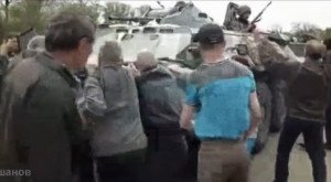 Civilians in eastern Ukraine stop Ukrainian tank in the early months of 2014, image from video by Artem Grishanov