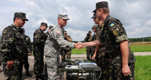 U.S. General Ben Hodges meets Ukrainian military officers. The U.S. has announced it will train the Ukraine army beginning in March 2015. That would be a violation of the ceasefire agreement in eastern Ukraine.