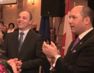 Andriy Parubiy (L) applauds Canadian Minister of Citizenship and Immigration Chris Alexander speaking to pro-Ukraine war fundraising event in Toronto Feb 22, 2015