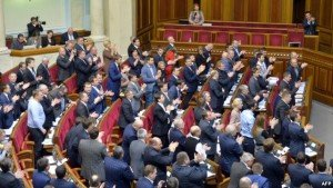 Deputies in Ukraine Rada applaud vote ending Ukraine's status as a non-aligned country, Dec. 23, 2014, photo by AFP