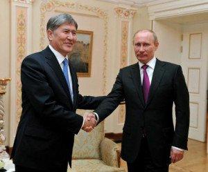 Vladimir Putin meets Kyrgystan President Almazbek Atambayev in St. Petersburg on March 16, 2015
