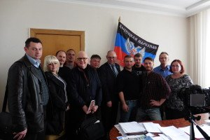 Media tour group meets Boris Litvinov (center), director of the finance and budget committee of the Donetsk People's Republic, April 16, 2015