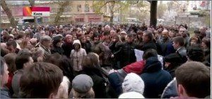 Mourners gather in Kyiv on April 19, 2015 for funeral of Oles Buzina