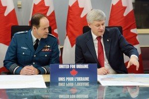 Prime Minister Stephen Harper announces Canadian soldiers to Ukraine, April 14, 2015. Beside him is Chief of Defence Staff Tom Lawson (Adrian Wyld, Canadian Press)