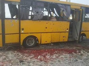 Bus hit by rockets at town of Volnovakha, Ukraine on Jan 13, 2015, image via RT