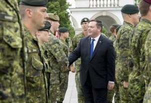 Canadian Defense Minister Jason Kenney greeting Canadian soldiers in Poland June 9, 2015 (DND photo, Cpl Precious Carandang)