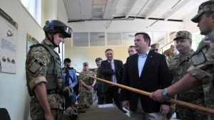 Ukrainian Defence Minister Stepan Poltorak, 2nd right, and Canadian Defence Minister Jason Kenney, center, visit army training center in Lviv region of Ukraine  June 27, 2015 (Pavlo Palamarchuk, AP)