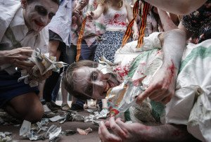 Activists in Kyiv dressed as zombies shred 'Vesti' newspaper at June 21, 2015 protest in front of the Security Service of Ukraine building demanding banning of the paper (Roman Pilipey, EPA)