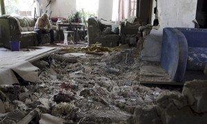 Resident of house hit by Ukrainian shelling in July 2015 (Alexander Ermochenko, Reuters)