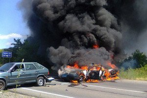 Two police cars burn after being hit by rocket grenades from Right Sector gangsters