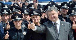 U.S. trained Ukrainian police graduates welcomed by President Poroshenko in Kyiv on July 4, 2015 (Sergie Supinsky, AFP)