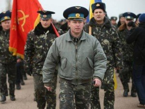Ukrainian troops in Crimea in March 2014 with hammer and sickle banner