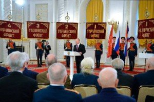 Vladimir Putin speaking before the banners of 1st, 2nd, 3rd and 4th Ukrainian Fronts of WW2
