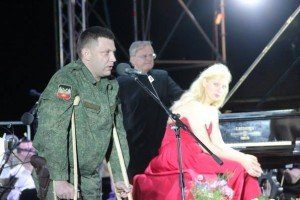 DPR President Aleksandr Zakharchenko, recovering from sniper bullet wound received five months earlier at Debaltseve, speaks to audience at June 21, 2015 concert of Valentina Lisitsa in Donetsk