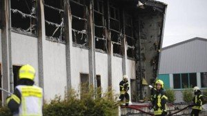 Gymnasium building intended as refugee housing center burned to the ground in Nauen, Germany on Aug. 25, 2015