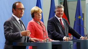 Hollande, Merkel and Poroshenko in Berlin on Aug. 24, 2015 (Axel Schmidt, Reuters)