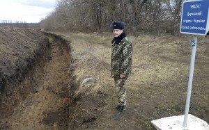 Ukrainian-Russian border in 2014 near Novoazovsk, Ukraine. Sign reads 'Attention! State border of Ukraine. Passage is prohibited' (Fedja Grulovic, Reuters)