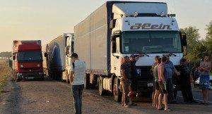 Trucks blocked by right-wing protest at Crimea-Ukraine border, Sept 2015 (Genya Savilov, AFP)