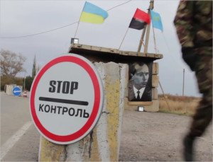 Portrait of Stepan Bandera adorns vigilante checkpoint at Ukraine-Crimea border, Oct 28, 2015 (YouTube screenshot)