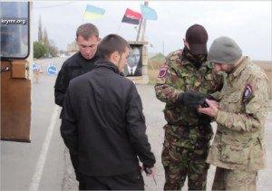 Portrait of Stepan Bandera in background at vigilante checkpoint at Ukraine-Crimea border, Oct 28, 2015 (YouTube screenshot)