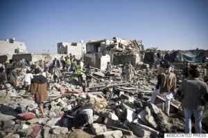Search for survivors in houses destroyed by Saudi airstrikes near Sanaa Airport, Yemen on March 26, 2015 (Hani Mohammed, AP)