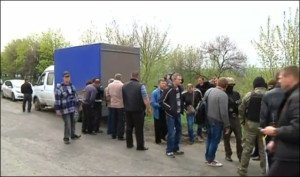 Image from Reuters of fateful attack by right-wing terrorists near Slavyansk April 20, 2014 pre-saging Kyiv's coming civil war