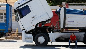 2013 photo of Turkish truck driver waiting at Turkey-Russia border crossing at Reyhani (Umit Bektas, Reuters)