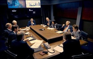 A real-life war room of former British military and diplomatic figures discuss and decide on a hypothetical 'hot war' in eastern Europe (BBC)