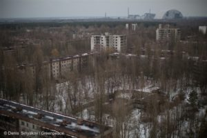Abandoned town of Pripyat, Ukraine. In background is the destroyed Chernobyl nuclear power station (Denis Sinyakov, Greenpeace)