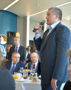 Sergei Aksyonov, Chairman of the Council of Ministers of the Republic of Crimea, speaks to foreign guests at economic forum in Yalta, April 2016 (Ulrich Heyden)