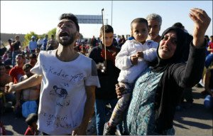 Woman holding a child reacts as Turkish police block migrants on a highway near Edirne, Turkey (file photo, Osman Orsal, Reuters)