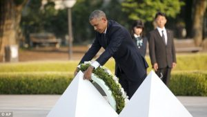 Barak Obama lays wreath in Hroshima, Japan on May 27, 2015. No apology but lots of crocodile tears for 1945 nuclear bomb (AP)