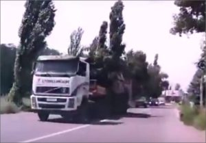 Dashcam video shot of a Buk missile convoy purportedly traveling Hwy H-21 in Makiivka, Ukraine on July 17, 2014 (YouTube screenshot)