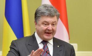 Ukrainian President Petro Poroshenko signs law in 2014 banning Russian films in Ukraine (AFP)