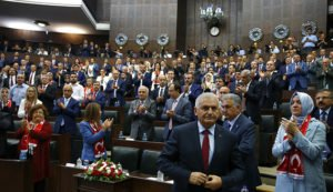 Turkish Prime Minister Binali Yildirim prepares to address members of parliament of his ruling Justice and Development Party (AKP) at the Turkish parliament in Ankara on July 19, 2016 (Umit Bektas, Reuters)