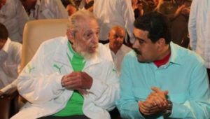 Fidel Castro and Venezuelan President Nicolas Maduro talk at Fidel's 90th birthday celebration in Havana (TeleSUR)