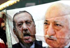 Images of Turkish President Erdogan (L) and Muslim cleric Fetullah Gulen