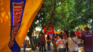 """The Zamoran banner reading """"Land and Free Men"""" accompanied the opening act of the anniversary of the El Maizal Commune."""