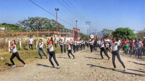A local high school marching band provided music and spectacle for the communal march through the heart of El Maizal Commune's productive units and farm lands.