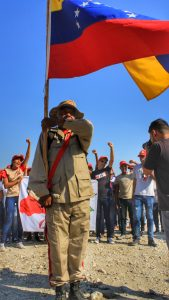 Local militia members showed their support for El Maizal Commune on their anniversary.