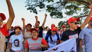 Communards enthusiastically shouted slogans as they marched through the communally owned farm lands.
