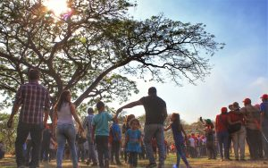 The communal march ended with a gathering under the mythical Samán tree where Chávez once stood.