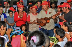 """The celebration closed with acoustic renditions of """"The International"""" and """"Bella Ciao"""" and the sharing of the many birthday cakes provided by the communally owned companies and production units."""